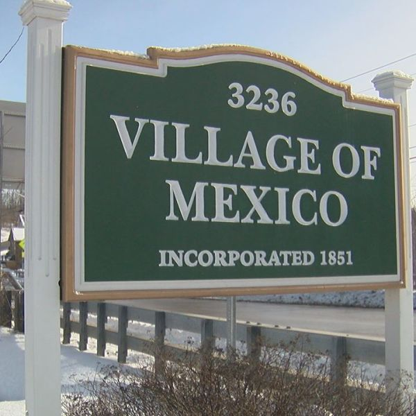 Village of Mexico sign in winter