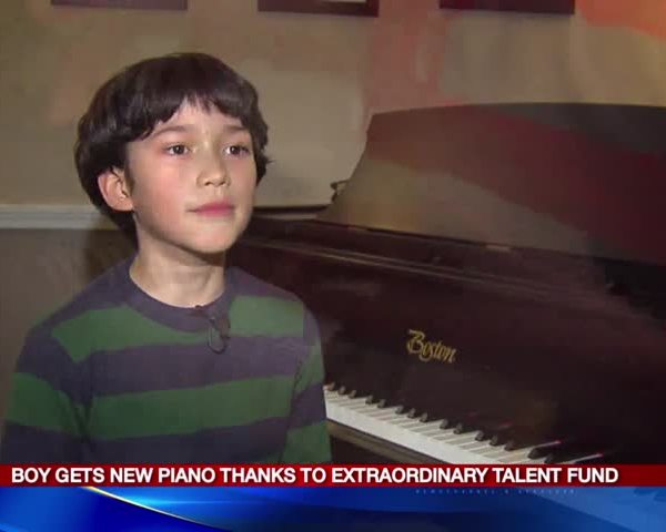 Fayetteville boy gets new piano thanks to Extraordinary fund_54515710-159532