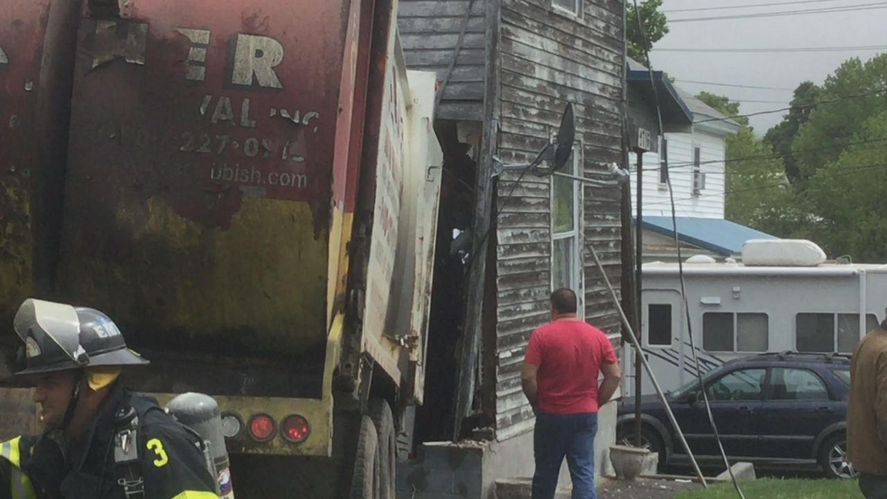 garbage truck into a home_1495826850390.jpg