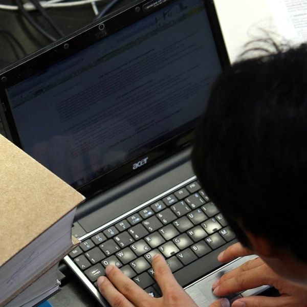 College student on laptop with books-159532.jpg16629068
