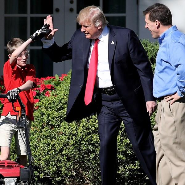 Trump high fives boy mowing White House lawn-159532.jpg53244713