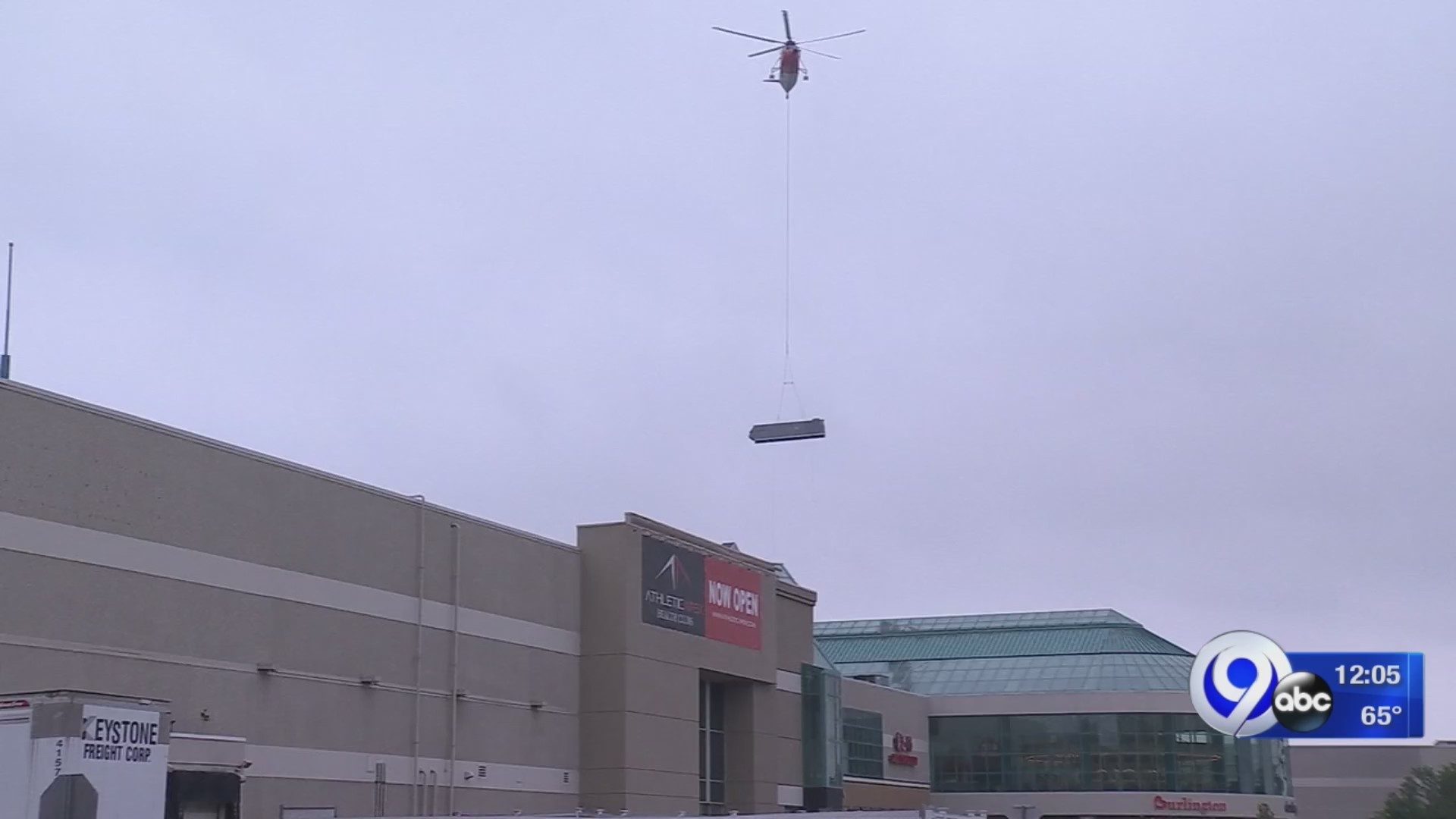 Helicopter delivers air conditioner to roof of Destiny USA