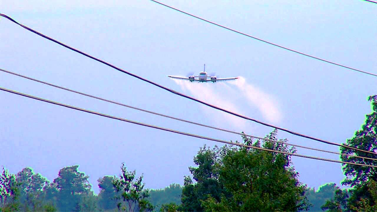 plane spraying mosquito pesticide