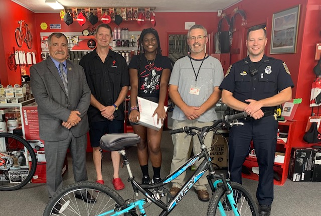 officers with student and bike