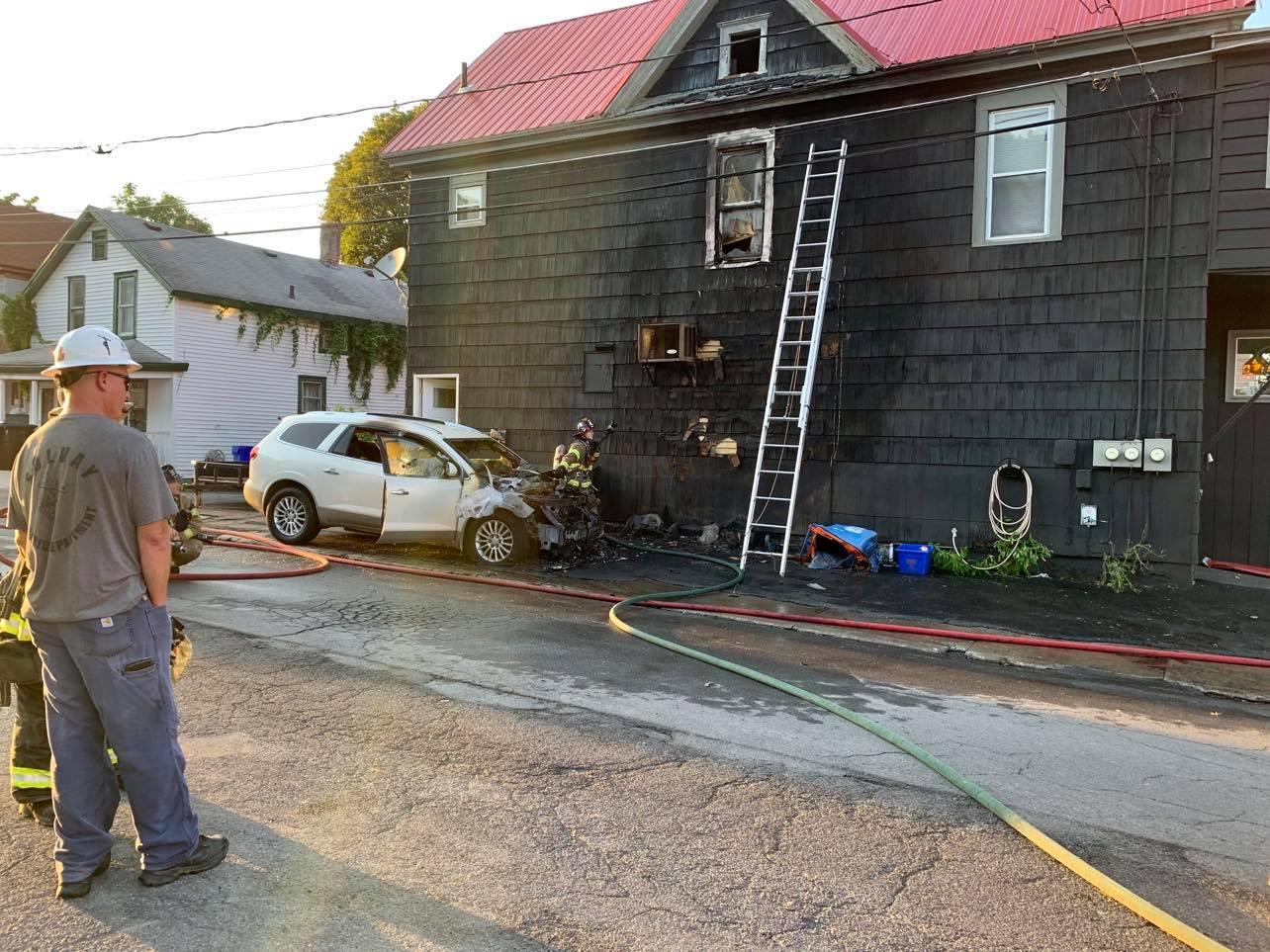 charred car next to restaurant