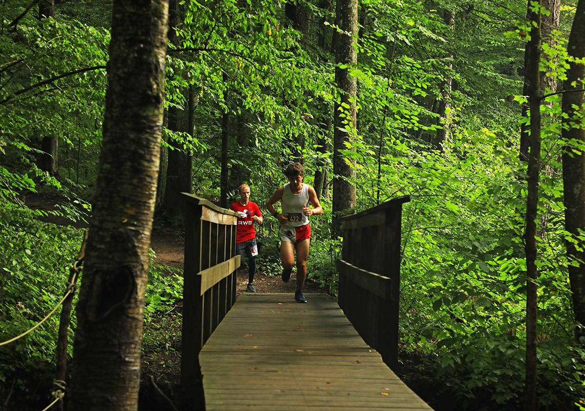 people running in woods